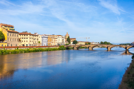 Colorful old buildings line the Arno River in Florence, Italy. Archivio Fotografico