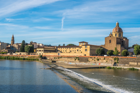 The Church of San Frediano and the Arno River spillway, Florence, Italy. Фото со стока