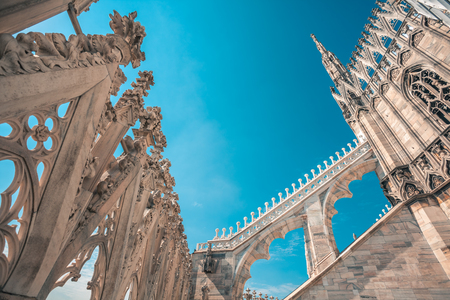 view of Gothic architecture and art on the roof of Milan Cathedral (Duomo di Milano), Italy.