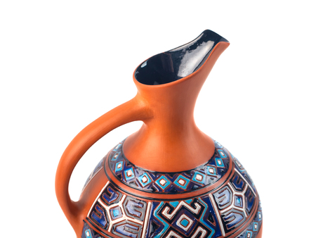 Georgian handmade ceramic jug with traditional ornaments on it, named Doqi, for wine and water on white background.