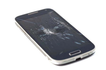 Mobile smartphone with broken screen isolated on white background. crack screen. Stock Photo