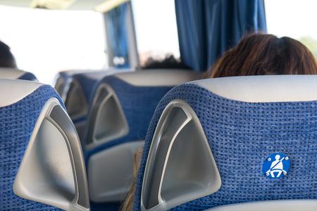 transport, tourism, road trip and equipment concept - travel bus interior and seats. Banco de Imagens - 107591103