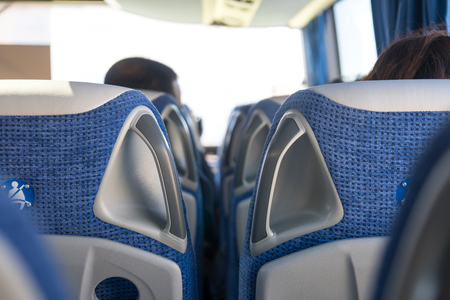 transport, tourism, road trip and equipment concept - travel bus interior and seats. Banco de Imagens - 107591165