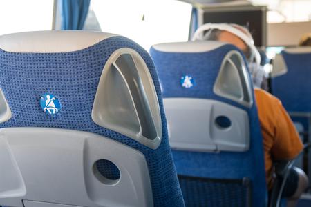transport, tourism, road trip and equipment concept - travel bus interior and seats. Banco de Imagens - 107591167