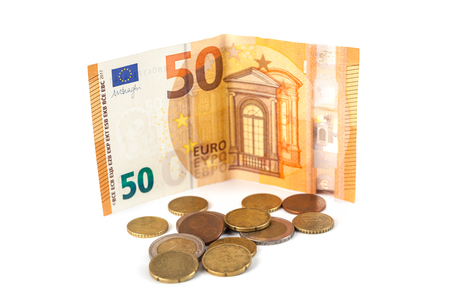 Stack of Euro banknotes and coins isolated. 50 Euro banknot.