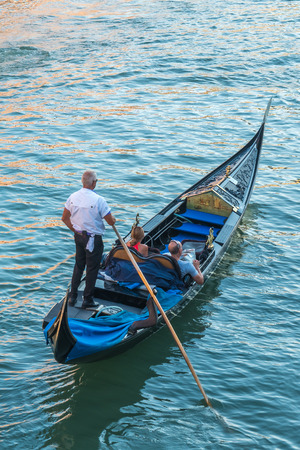 Tourists in gondolas on canal of Venice, Italy. Banco de Imagens