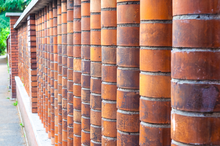 The pillars of the fence made of red brick shaped. Banco de Imagens