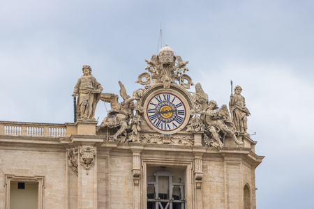 Vatican city travel sculpture around the clock tower, tourism.