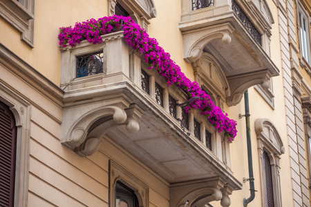 houses with flowers on the windows in Milan, Italy.