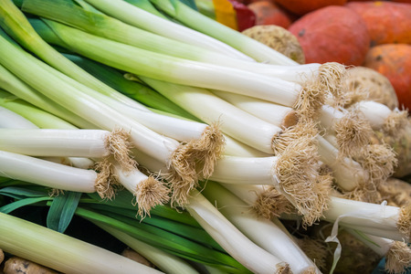 Leek and verious vegetables for sale at a market.