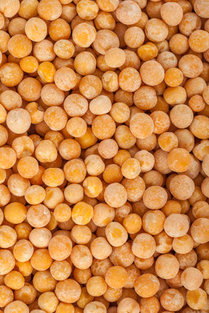Yellow mustard seeds for backgrounds or textures, healthy food. Stock Photo