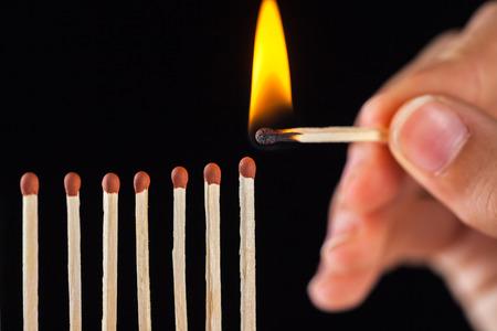 group of burn and unburned matches, isolated on black background. Standard-Bild