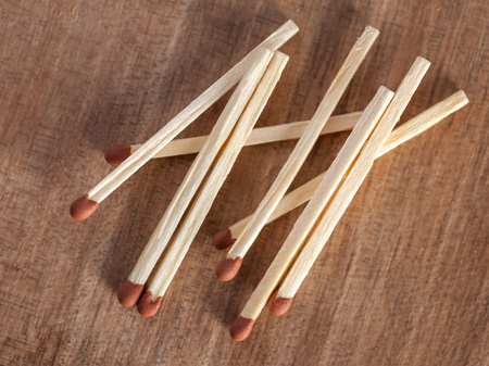 Wooden matches sticks on a wooden table background. Фото со стока