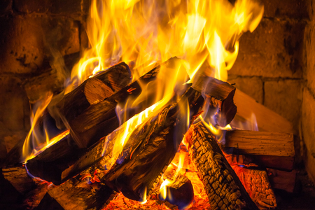 Wood burning in a cozy fireplace at home, keep warm. 版權商用圖片