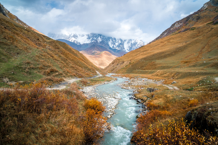 The valley of the Enguri river in autumn. The highest peak of Georgia is Shkhara. Main Caucasian ridge, Zemo Svaneti.