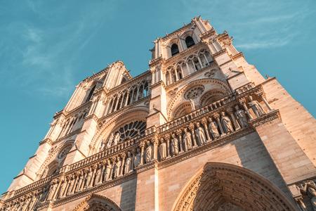facade of notre dame de Paris, medieval cathedral (church) in paris, france.