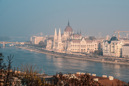 View of Hungarian parliament at Danube river in Budapest city, Hungary.