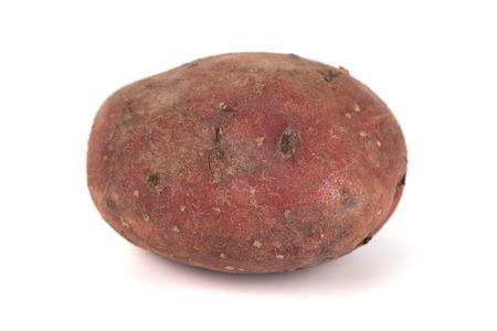 red sweet large potato close up isolated on white background. 免版税图像