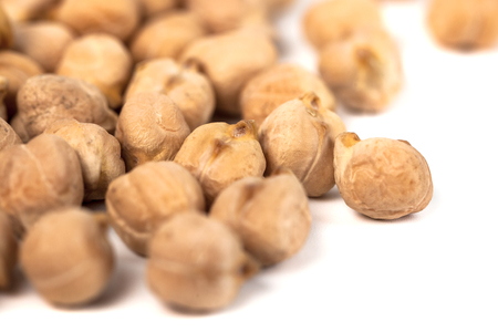 Dry raw organic chickpeas isolated on white background, healthy food