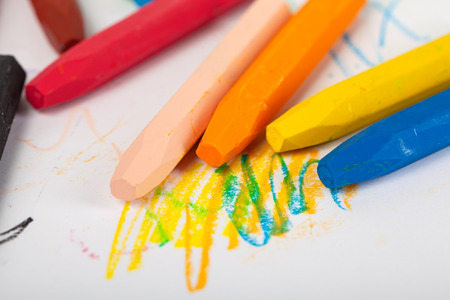 Group of crayons (pencils) stacked on white background, art tools