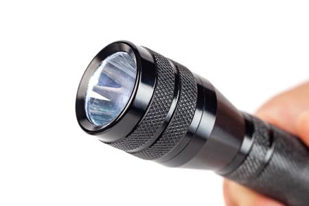 Hand holding flashlight on white background, tools Banco de Imagens