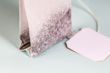 tea bags with white label isolated on light background, object