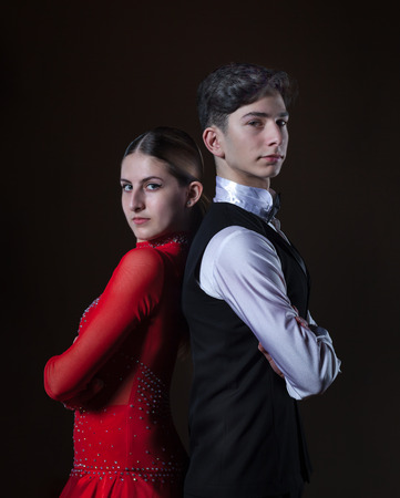 Beautiful young dancers in ballroom isolated on black background, couple dance Standard-Bild