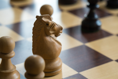 wood chess pieces on board game, intelectual sport