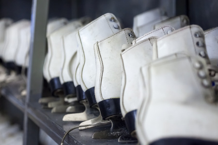 Rows of white ice skates,  winter sports equipment 写真素材