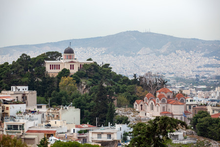 Church Agia Marina and National Observatory on the Hill of Nymphis in Athens, Greece, travel Stock Photo