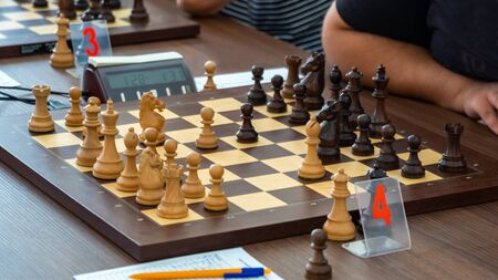 chess pieces on the board in the chess tournament. Sport. Stock fotó
