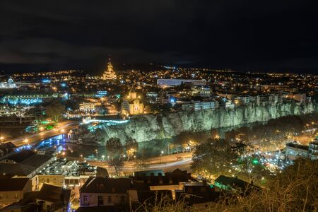 Beautiful night view of Tbilisi area from the hill. Travel. Banco de Imagens
