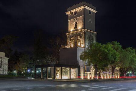 Night view of old clock tower in Poti, Niko Nikoladze tower. Georgia. Travel. Standard-Bild