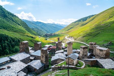 View of the Ushguli village at the foot of Mt. Shkhara. Picturesque and gorgeous scene. Rock towers and old houses in Ushguli, Georgia. Travel. Banco de Imagens