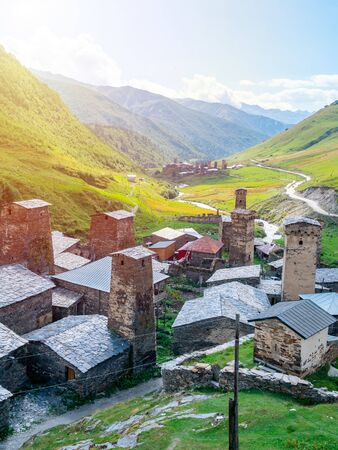 View of the Ushguli village at the foot of Mt. Shkhara. Picturesque and gorgeous scene. Rock towers and old houses in Ushguli, Georgia. Travel. Zdjęcie Seryjne