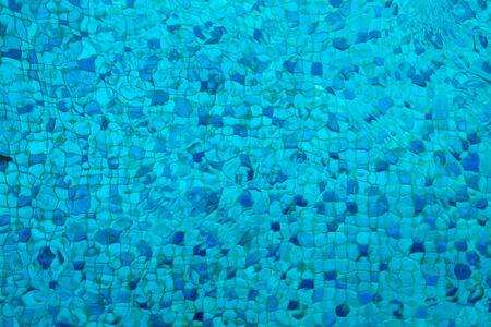 Swimming pool blue mosaic rock bottom. Texture. Background.