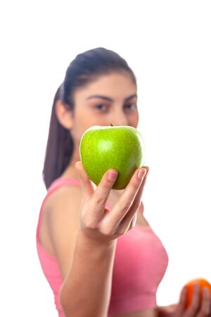 Beautiful young healthy girl with apple and measure. Diet. Isolated on white background. Sport. Stock Photo