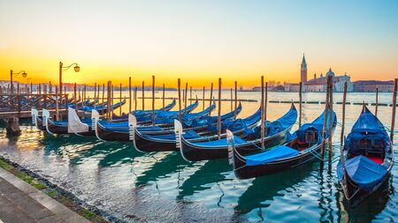 Sunrise in Venice, gondolas and island of St. George view from the square San Marco. Travel. Stock Photo