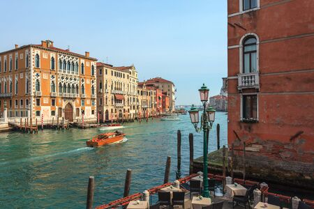 View of Canal Grande. Various boats float by a fine architectural complex of embankments. Travel. 免版税图像