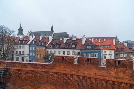 Warsaw, Poland Famous Barbican old town historic capital city during rainy winter day and red orange brick wall fortress architecture. Travel. 免版税图像