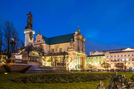 Mickiewicz Monument and Church of the Assumption of the Virgin Mary and of St. Joseph known as the Carmelite Church at night. Travel.