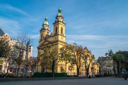 Beautiful yellow church in Budapest, Hungary. Religion. Travel. Reklamní fotografie
