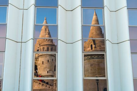 Matthias Church reflection. Fisherman bastion with details on the facade and the whole scene of the castle in Buda, Budapest. Travel.