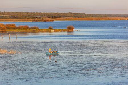 A litte boat and the fishermen on the lake Paliastomi. Poti. Georgia. Nature.