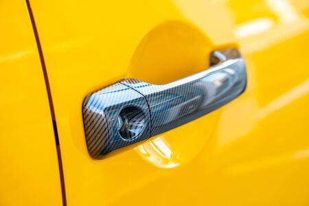 Car Door Lock and Handle. Yellow color. Transportation. Zdjęcie Seryjne