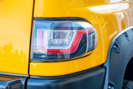 headlight of modern yellow color car closeup. Transport.