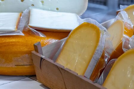 Various Holland cheese on in diary production market. Food. 免版税图像 - 133736971