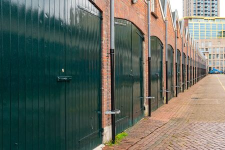 A row of garages for rent in Eindhoven, Netherlands. Buildings.