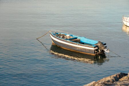 Fishing boat floating on the Mediterranean sea shore. Italy. Seascape.