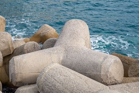 Breakwater of concrete tetrapods in Amalfi coastal town. Mediterranean Sea.